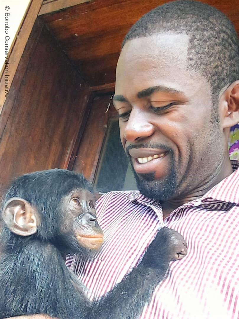 Orphan Esake with BCI partner Héritier Mpo